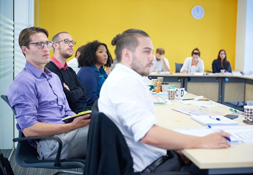 A class of project management delegates looking attentive